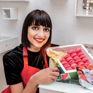 Rosie Ginlay holding a tray of macarons